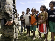 US soldiers visit East Timor, meet young boys, June 2010