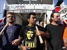Strikers block the entrance to a ferry in Piraeus, Greece, 29 June 2010