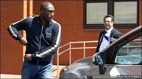 Sol Campbell heads for his car at Celtic Park