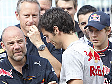 Mark Webber (centre) and Sebastian Vettel (right)