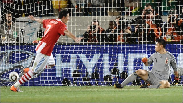Oscar Cardozo scores in the winning penalty to defeat Japan.