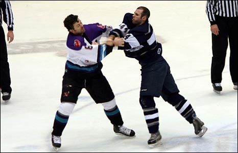 Cedric Bernier (right) tussles with an opponent