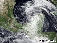Handout satellite image of Tropical Storm Alex in the southwestern Gulf of Mexico as it closes in to land near the Mexico-Texas border on June 28, 2010, before it became a hurricane