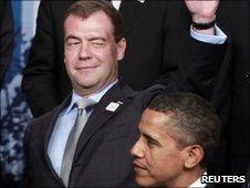 Russian President Dmitry Medvedev winks while standing next to US President Barack Obama
