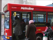 Passengers board a London bus