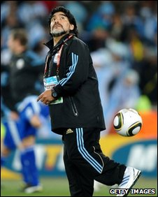 Maradona backheels the ball on the sidelines