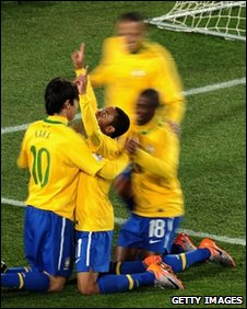 Brazil players celebrate with Robinho