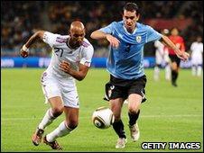 Uruguay defender Diego Godin and Nicolas Anelka