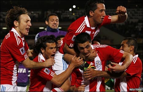Paraguay celebrate their penalty shoot-out success against Japan