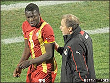 Ghana midfielder Sulley Muntari with coach Milovan Rajevac