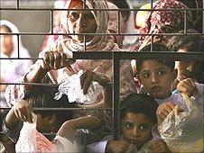 Women and children receive free food at the shrine of Muslim Saint Data Ganj Bakhsh in Lahore