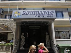 Women pass outside of the hotel where Christopher Metsos was believed to have been staying in Larnaca, Cyprus, on 30 June 2010