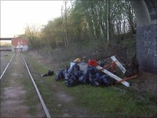 Rubbish beside railway