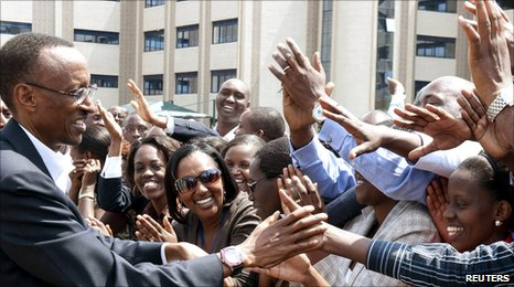 Rwanda's President Paul Kagame greets supporters after presenting candidature documents to an electoral commission in the capital Kigali 24 June 2010