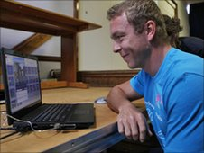 Sir Chris Hoy on a laptop at Hartford High School