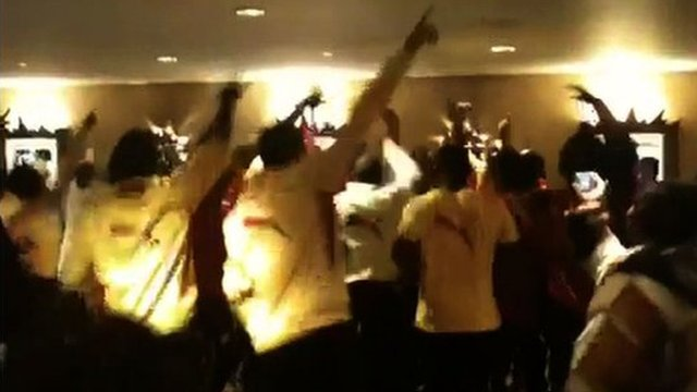 Ghana players singing and dancing