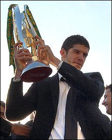 Norwich City goalkeeper Fraser Forster with the the trophy