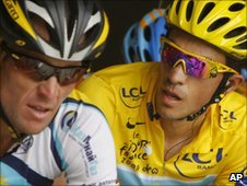 Alberto Contador (right) looks at former team-mate Lance Armstrong  during the 16th stage of the 2009 Tour