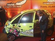 Tata Motors chairman Ratan Tata looks at the Tata Nano car at a ceremony in Mumbai