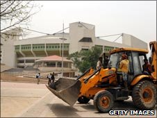 Clearing debris outside The Indira Gandhi Indoor Stadium Complex