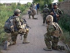 Scots Guards and Afghan soldiers on patrol