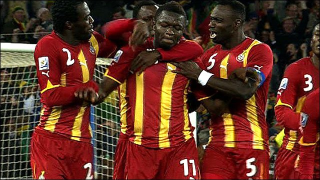 Sulley Muntari is congratulated by his Ghana team-mates