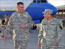 Gen David Petraeus (right) arrives in Kabul