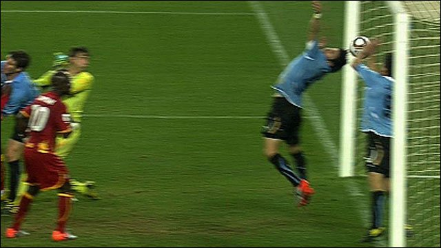 Uruguay striker Luis Saurez handles on the line