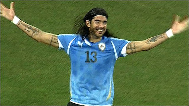 Uruguay's Sebastian Abreu celebrates his winning penalty