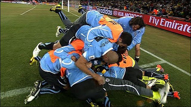 Uruguay players celebrate beating Ghan