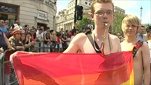 Man with rainbow flag and whistle