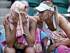 Vera Zvonareva is consoled by partner Elena Vesnina after their defeat in the women's doubles final on Centre Court at Wimbledon