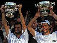 Philipp Petzschner (left) and Jurgen Melzer (right) hold up their trophies on Centre Court at Wimbledon