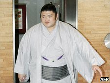 Sumo wrestler Kotomitsuki arrives at the Japan Sumo Association's executive meeting on 4 July 2010