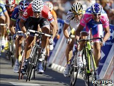 Alessandro Petacchi of the Lampre team (right, in pink) sprints to victory on stage one