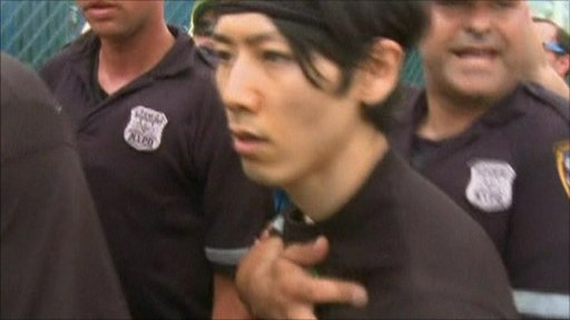 Takeru Kobayashi being arrested in New York