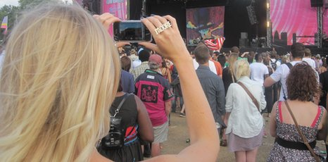 Music fan holding mobile phone