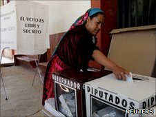 A woman votes in Oaxaca