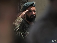 An Afghan soldier salutes during the change-of-command ceremony in Kabul on 4/7/2010