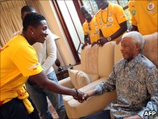 Ghanaian striker Asamoah Gyan (L) meets former South African President Nelson Mandela at his Johannesburg home - 3 July 2010