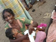 Injured Tamil woman and child, 2009 file pic