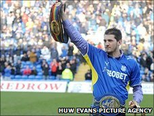Nathan Cleverly shows off his belts at Cardiff City Stadium
