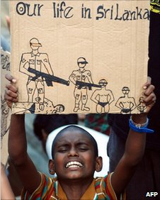 A young Sri Lankan asylum-seeker holds up a placard during a protest (2009)