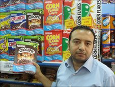 Hani Asri in his supermarket