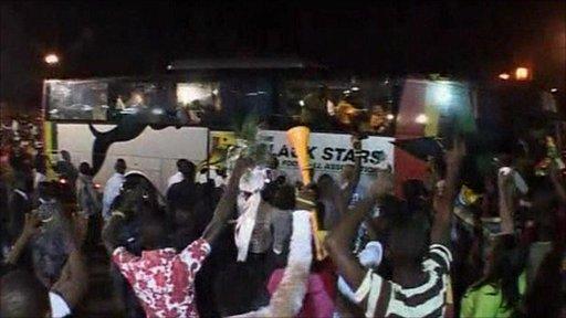 Ghana team coach and fans cheering