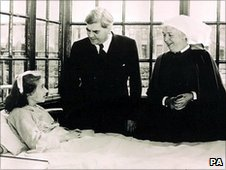 Bevan visits Sylvia Diggory, the first NHS patient, at Trafford General Hospital in 1948