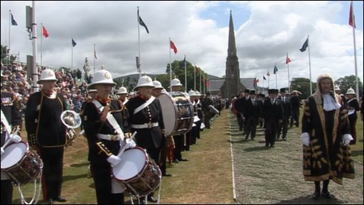 Government officials and dignitaries make their way from the church to Tynwald Hill.