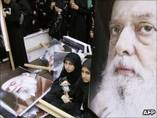 Shia women sit next to pictures of Ayatollah Sayyed Mohammed Hussein Fadlallah as they attend his funeral in Beirut's southern suburb 6 July 2010.
