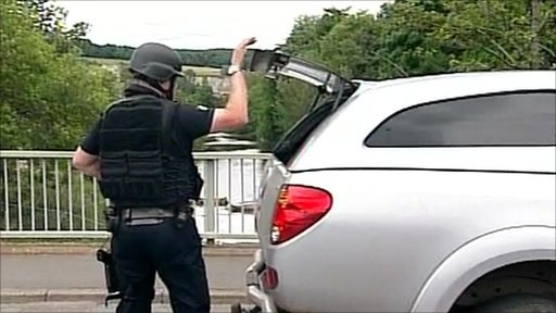 Armed police searching cars for gunman