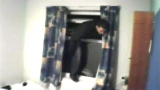 Burglar caught on CCTV breaking into a university hall of residence on Thursday, 3 June 2010